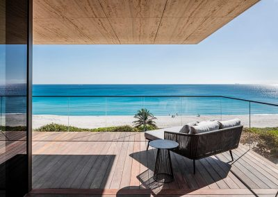 Photograph of a terrace at Arte Surfside condo with a view of the ocean.