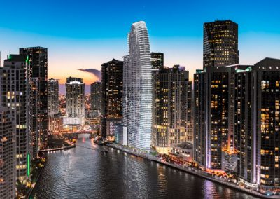 3D rendering sample of Aston Martin Residences at night with neighboring buildings.