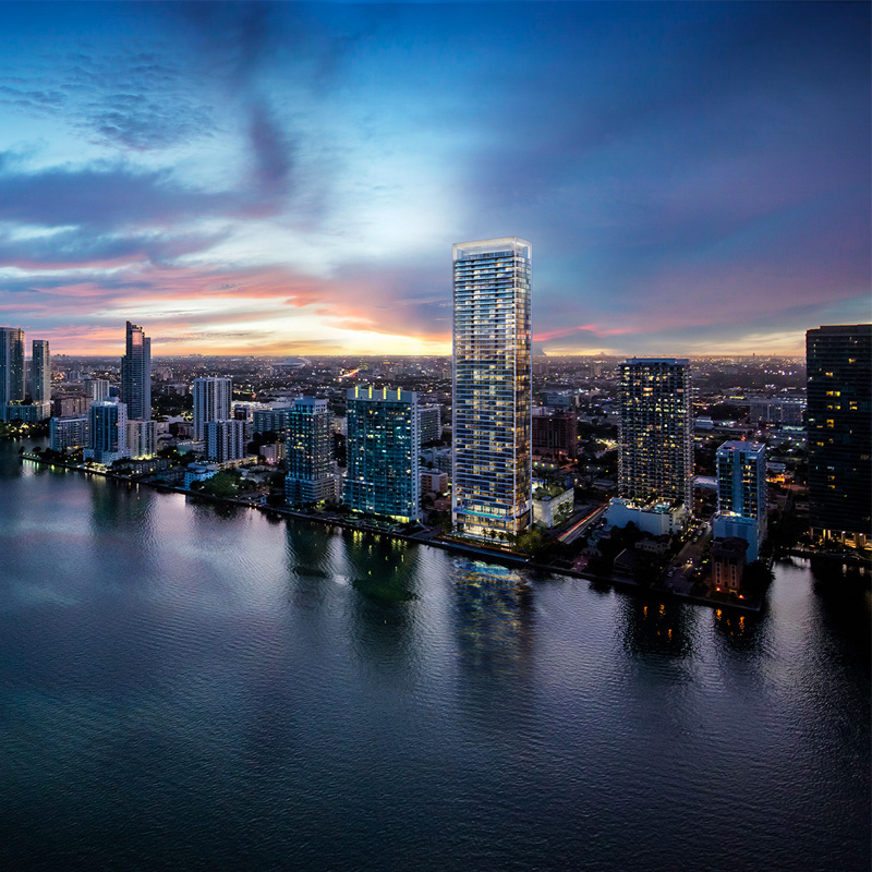 3D rendering sample of the exterior design for Missoni Baia condo at dusk with neighboring buildings.