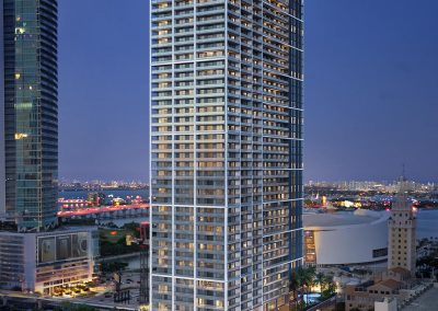 3D rendering sample of the building design for Natiivo Miami condo at night.
